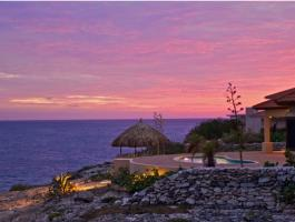 This beautiful 3 bedroom oceanfront villa offers magnificent views