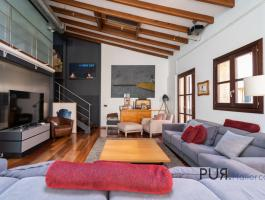 Palma. A loft. Right in the middle of the old town. Really stylish.